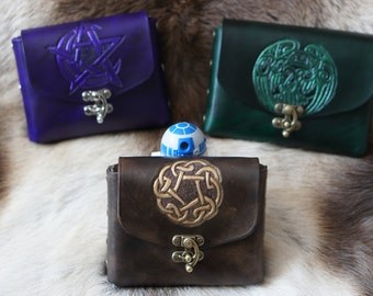 Hand carved leather belt pouches with Celtic and Pagan Designs