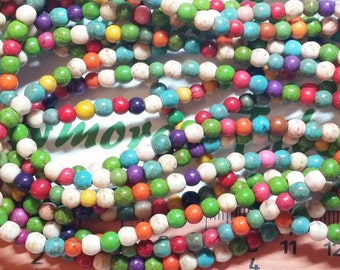 16 inches of 4mm Round Multi-color Bluish Dyed Magnesite Beads.