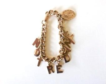 Souvenir Charm Bracelet Gold toned Notre Dam Catholic Letter Charms