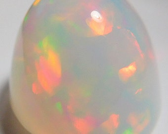Welo Contra luz crystal opal designer cab 6.02 ct high dome oval  Blues,reds, yellow and green fire solid