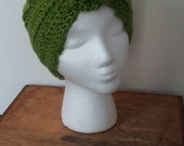 Becca Cook - Green Glitterific Child's Hat. Crochet flower beanie with fancy trim.