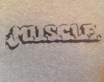 M.U.S.C.L.E. muscle men toys TSHIRT or ONESIE