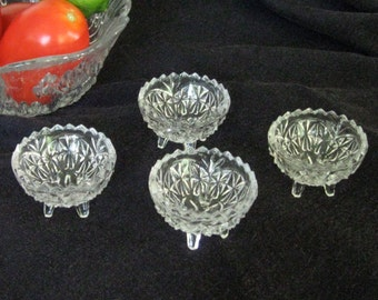 Set of 4 vintage pressed glass open salts with 4 feet, rare