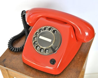 Red working rotary telephone T65 modified for modern lines