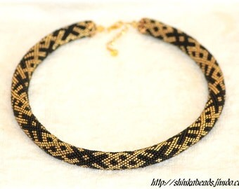 Ethnical ornament bead crochet necklace black and golden handmade unique OZOLINS pattern