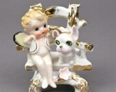 Authentic Vintage Cheerio Halo Baby Angel with Bug Wings with her Dog Sitting on a Rustic Chair, Ceramic Made in Japan