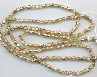 One 16-inch strand 4 mm crystal/metallic gold glass firepolished beads 500