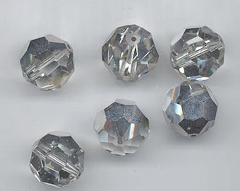Twelve dazzling vintage Swarovski crystal beads: Art. 5000 - 14 mm crystal comet argent light