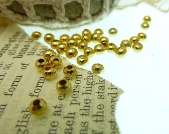 50 tiny shiny brass beads 4 mm round