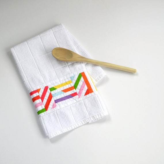 Kitchen Towels Keep a practical and absorbent kitchen towel handy for sudden spills and a note of charm. Choose from flour sack dish cloths, seasonal designs and a dash of humor.