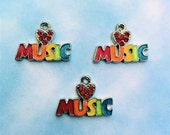 4 pc. set of Enameled Love Music Charms with Crystals in the Center of the Heart (style C502) (free combined shipping)