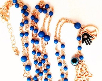 Rosary style blue and gold Hamsa peace evil eye wishbone necklace