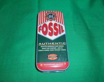 One (1), Fossil Watch, Tin Box. Circa 1993.