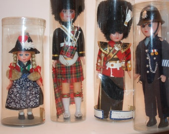 Vintage set of Four Hard Plastic Dolls In Uniform Representing Different Countries, Still in Original Boxes, Eyes Open and Close