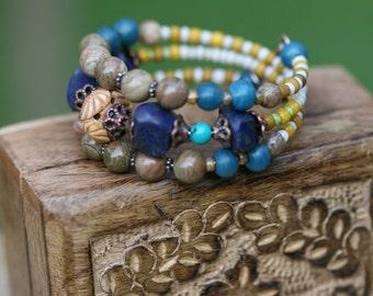 From My Shades of Gray Gipsy Bangle Stack Beaded Bracelet- Festive, Carved Bone,Tribal, Boho, Bohemian,Lapis Lazuli tassel,earthy Agate