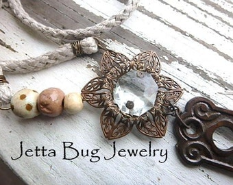 The Long and Winding Road- vintage copper flower. steampunk flower. vintage metal button. faun leather. mixed metal jewelry. Jettabugjewelry