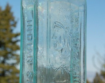 Original Antique INDIAN SAGWA bottle, Total Quack CURE from the 1800's - w/ pic of Indian Chief embossed in glass!  This is the Real Thing