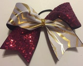 """3"""", 3 inch cheer bow all star cheer bow marroon sequins and gold and white holgoraphic zebra spandex on grosgrain ribbon"""