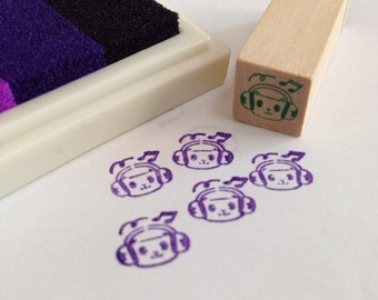 A mini Wooden Rubber Stamp: Monkey with Music