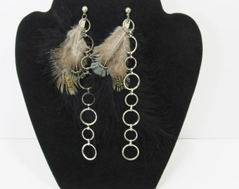 Gorgeous feather and chain pierced earrings.
