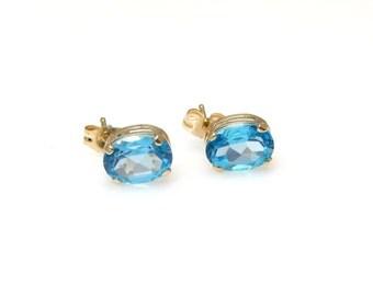14k Blue Topaz Stud Earrings - Sky Blue Oval Blue Topaz - Pierced - Post Back - December Birthstone