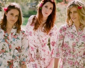 Set of 5 knee length robes. Bridesmaid robes and bridal robes in pastel floral prints and botanical prints. Cotton floral robes.