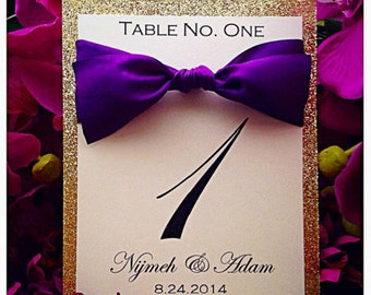Gold glitter table number with silk ribbon