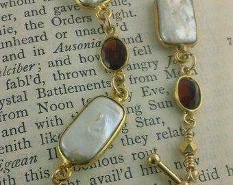 Regal Oval Garnet and Freshwater Pearl Bracelet hand-wrapped in golden Vermeil