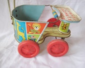 Rustic tin doll stroller, vintage toy, metal baby doll carriage, push cart