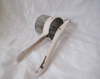 Vintage potato ricer, cutlery, vintage kitchen utensils, display utensils, mid century, 50s 60s