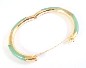 Light green bangle bracelet with gold fittings and clasp