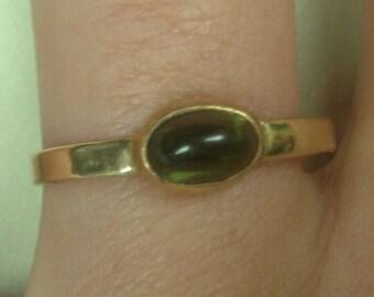 Yellow Gold and Oval Cabachoun Peridot
