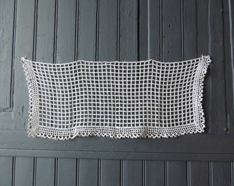 A vintage , hand made, crocheted lace, cafe curtain, dresser, or runner panel