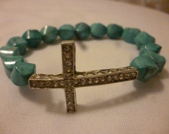 Turquoise howlite and cross stretch bracelet