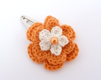 1 Orange and cream crochet flower hair clip.