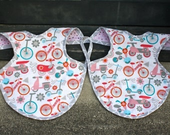 TWO Bicycle & Scooter apron stype bibs. Bapron Style.  Pink cotton bibs, polka dot flannel on reverse.
