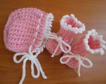 Newborn baby girl booties and bonnet, pink with white picot edge