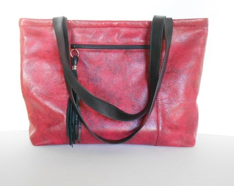 Red leather shoulder bag or tote, with pockets.