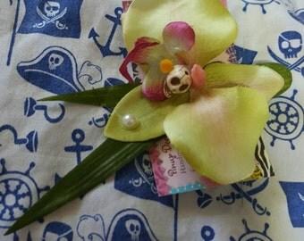 Rockabilly/ tiki hair flower on clip.  Green orchid w/ skull..also in pink!