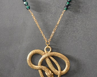 14K Gold filled chain * Gold and emerald tone beads * Gold plated snake pendent