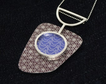 Flower and bird abstract pendant
