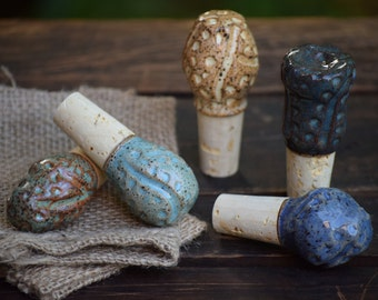 set of 5 stoneware wine stoppers with burlap pouches