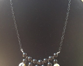 Yellow, white and black necklace