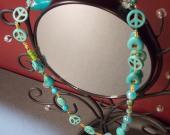 Turquoise peace and heart necklace with a hint of green.