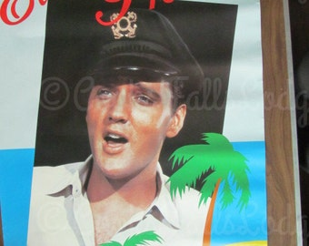 ELVIS PRESLEY RARE 1986 Black Captain's hat colored poster.  Early photo taken in 1961 while filming Blue Hawaii of The King of Rockn'roll!!