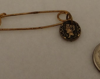 Old Coin on Safty Pin