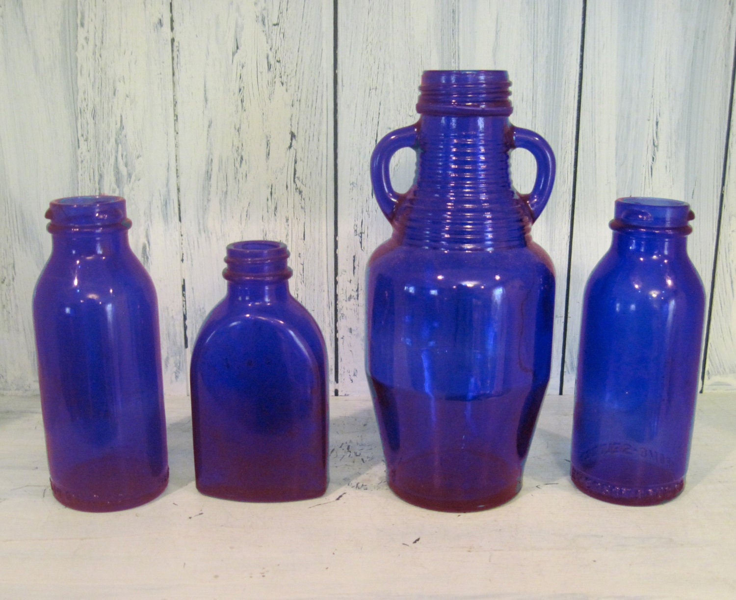 vintage decorative colored glass bottle set of 4 dark blue