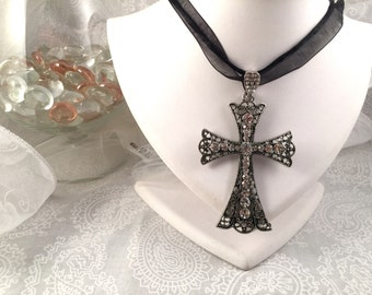 Silver Tone Cross with crystals on black, ribbon and cord multi-strand necklace