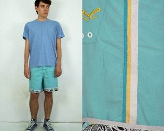 90's vintage men's blue swimwear shorts
