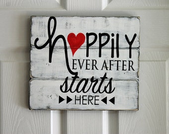 Happily Ever After Starts Here sign painted on  reclaimed wood.